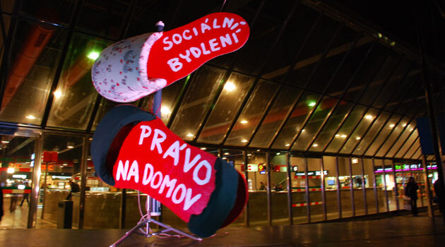 A 2013 demonstration by the Platform for Social Housing in front of Prague's main train station. The sign reads