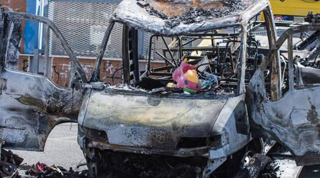 The burned-out caravan after an arson attack in Rome, Italy, during which three Romani sisters ages four, eight and 20 died on 10 May 2017. (PHOTO:  Corriere della sera)