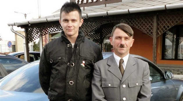 The mayor of the Hungarian town of  Ózd, Dávid Janiczak, captured in this photograph with a double of Adolf Hitler. After the image was published, Janiczak claimed to the media that he disagrees with Hitler and would have taken the same kind of photo with a double of George Bush or Elvis Presley...