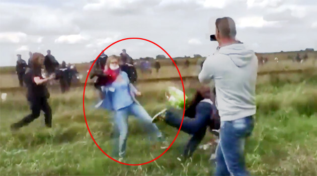 Hungary was shaken in September 2015 by a brief video taken at its border with Serbia showing a camerawoman for Hungary's N1TV station kicking young refugee boys and girls and tripping a refugee carrying a child as they made their way through a Hungarian Police cordon. (PHOTO:  YouTube.com)