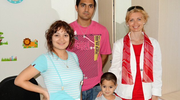 Czech Government Human Rights Commissioner Monika Šimůnková visiting the Romani family who gave birth to the first quintuplets ever delivered in the Czech Republic in 2013.