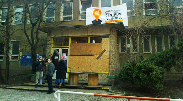Boards over the broken display window at the Klinika Social Center in the  Žižkov quarter of Prague. The photograph was taken on 7 February 2016. On Saturday, 6 February 2016,  a group of about 20 masked persons attacked the center in the evening with flares and rocks. (PHOTO:  František Kostlán)
