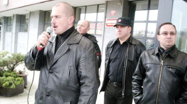 Kotleba (holding microphone) is pictured here with his friends from the Workers Social Justice Party in the Czech Republic.