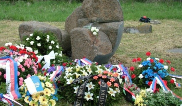 Wreaths laid at the memorial at Lety by Písek, Czech Republic, on 10 May 2014 during the ceremony annually held by the Committee for the Redress of the Roma Holocaust, which is regularly attended by diplomatic representatives and survivors. (Photo:  František Kostlán)