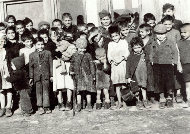 This photograph shows a group of children imprisoned at the concentration camp of Lety by Písek, where they died primarily of cold and hunger. (PHOTO:  Academy of Sciences of the Czech Republic/Akademie věd ČR)