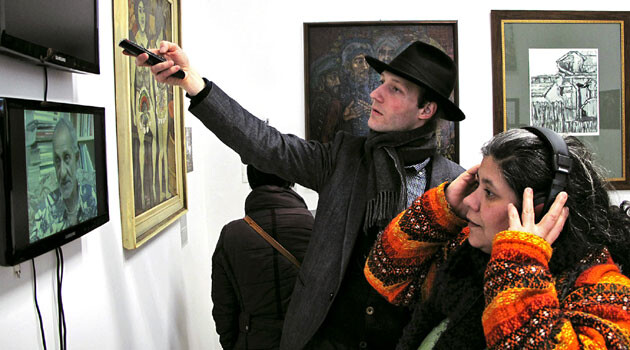 Visitors at the opening of an exhibition at Gallery8 in Budapest, a space for Romani contemporary art, in February 2013. (PHOTO:  © Nihad Nino Pusija)