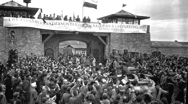Liberated prisoners welcome soldiers at Mauthausen. (PHOTO:  U.S. Federal Government, Wikimedia Commons)