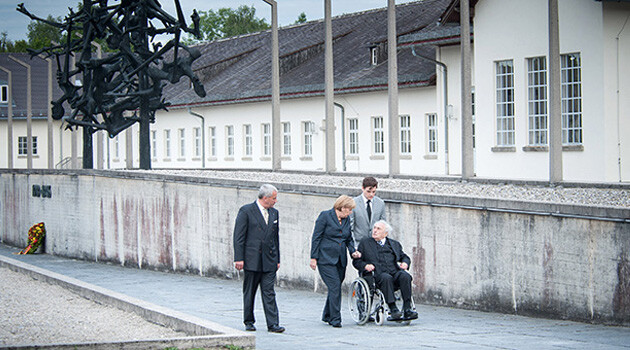 German Chancellor Angela Merkel became the first head of Government to officially visit the memorial at the site of the former concentration camp at Dachau on 20 August 2013 (PHOTO:  Bundesregierung/Bergmann)