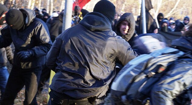A photograph taken of the assault on human rights activist Ondřej Cakl during the 2008 ultra-right riot at the Janov housing estate.