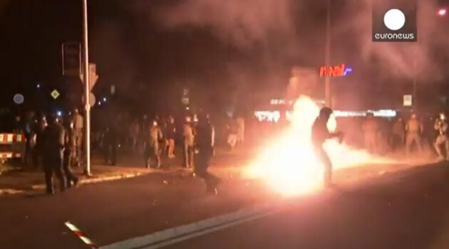 An initially calm protest against accommodating asylum-seekers in a newly-opened refugee center in the town of Heidenau, Germany grew overnight into a violent clash between extremists and police on 22 August 2015 (PHOTO:  YouTube.com, Euronews).