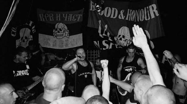 Tomáš Hnídek, alias Tomáš Ortel, shown here singing with his first neo-Nazi band, Conflict 88.