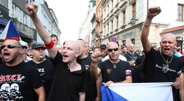 The lead singer for the Czech neo-Nazi band Ortel (left) was photographed participating in this anti-Romani march on 24 August 2013 in Plzeň, which was attended by approximately 150 neo-Nazis. (Source: csaf.cz)