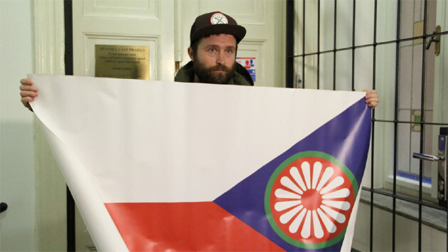 The artist Tomáš Rafa shows one of the designs for a Czech-Romani flag. The confiscated flags were returned to him on 26 January 2015. (PHOTO: František Bikár)