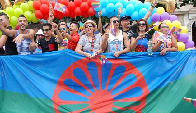 Marchers holding the international Romani flag during Prague Pride 2016. (PHOTO:  Yveta Kenety)