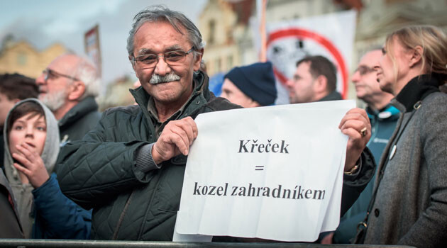 Romani activist Čeněk Růžička on 1 March 2020 at the Million Moments for Democracy demonstration. The sign reads