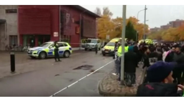 Police officers in front of the school in the town of Trollhättan in southwestern Sweden after a sword-wielding assailant injured two people and killed two in October 2015. (PHOTO:  Guardian Wires)