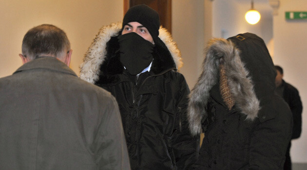 Two neo-Nazis who began to testify on 9 February 2015 regarding a 2012 arson attack against a residential hotel in Aš could face extraordinary sentencing. Another seven members of the radical group are on trial (two of whom are depicted here, one in the center and one on the right), mainly for promoting and supporting a movement aimed at suppressing human rights and freedoms. (PHOTO:  Czech News Agency)