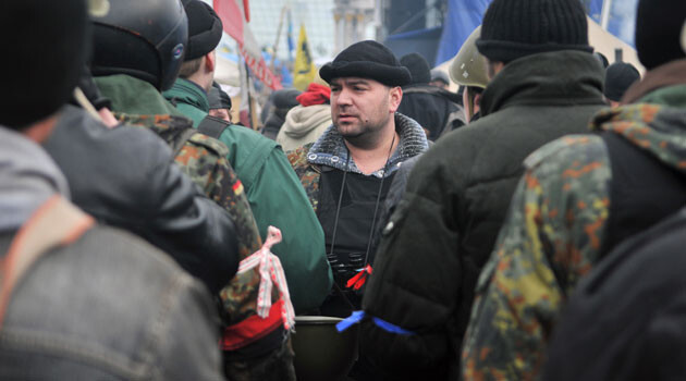 This photo shows right-wing radical units among the demonstrators in Kiev, Ukraine in early 2014. The black and red armband means they probably espouse either the Banderites or the Right Sector group. (PHOTO:  Vít Hassan)
