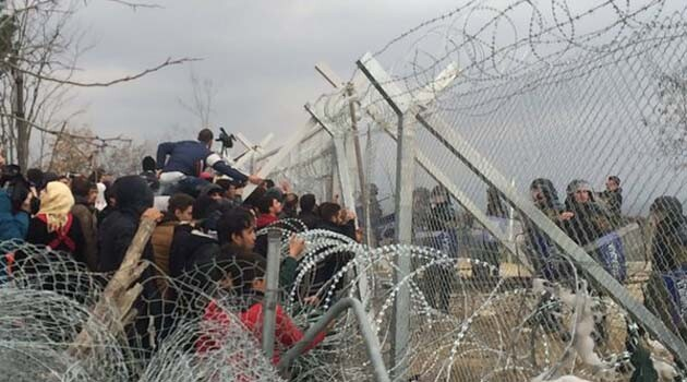 Refugees in front of the fence on the Greece-Macedonia border, 2016. (Photo: Monika Kalinowska, pic.twitter.com/dvL96my3EO)
