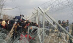 Refugees approaching fence the border Greece with Macedonia,