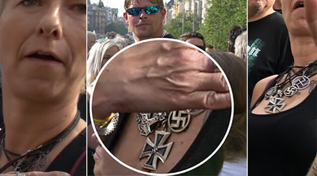 A woman with her collection of Nazi swastikas around her neck on 25 April 2019 during a demonstration on Wenceslas Square in Prague by the populist-xenophobic