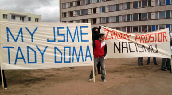 "Romani residents counter-protesting today's neo-Nazi march. The signs read ""This is our home"" and ""No room here for Nazism""."